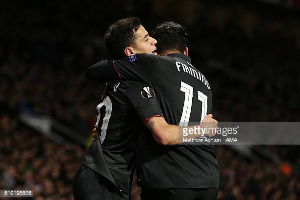 Philippe Coutinho of Liverpool celebrates scoring his team's first goal with teammate Roberto Firmino during the UEFA Europa League Round of 16...