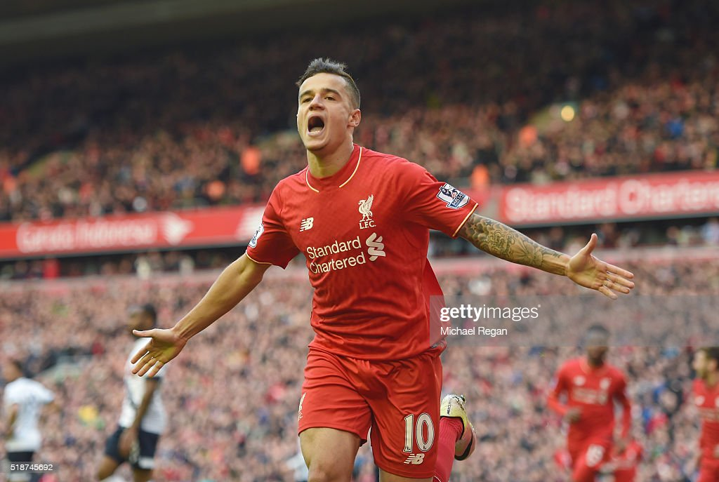 Philippe Coutinho of Liverpool celebrates scoring his team's first goal during the Barclays Premier League match between Liverpool and Tottenham Hotspur at Anfield on April 2, 2016 in Liverpool, England.