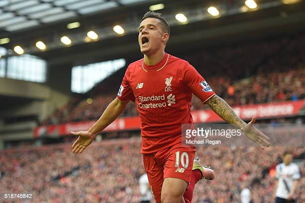 Philippe Coutinho of Liverpool celebrates scoring his team's first goal during the Barclays Premier League match between Liverpool and Tottenham...