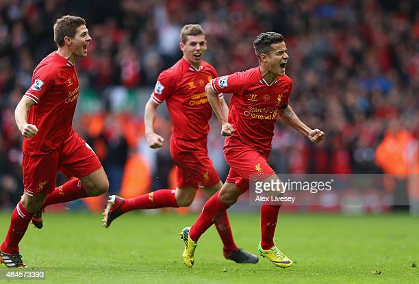 Philippe Coutinho of Liverpool celebrates scoring his team's third goal during the Barclays Premier League match between Liverpool and Manchester...