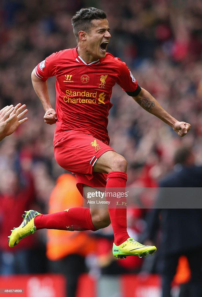 Philippe Coutinho of Liverpool celebrates scoring his team's third goal during the Barclays Premier League match between Liverpool and Manchester City at Anfield on April 13, 2014 in Liverpool, England.
