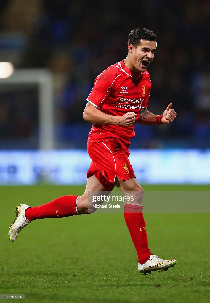 Philippe Coutinho of Liverpool celebrates scoring their second goal during the FA Cup Fourth round replay between Bolton Wanderers and Liverpool at Macron Stadium on February 4, 2015 in Bolton, England.