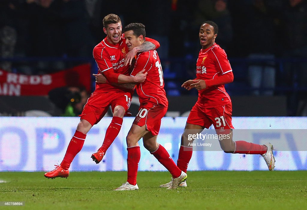 Philippe Coutinho of Liverpool celebrates scoring their second goal with Alberto Moreno and Raheem Sterling (R) of Liverpool during the FA Cup Fourth round replay between Bolton Wanderers and Liverpool at Macron Stadium on February 4, 2015 in Bolton, England.