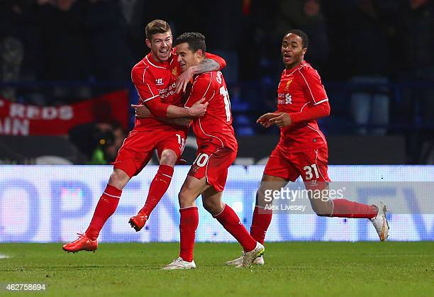Philippe Coutinho of Liverpool celebrates scoring their second goal with Alberto Moreno and Raheem Sterling of Liverpool during the FA Cup Fourth...