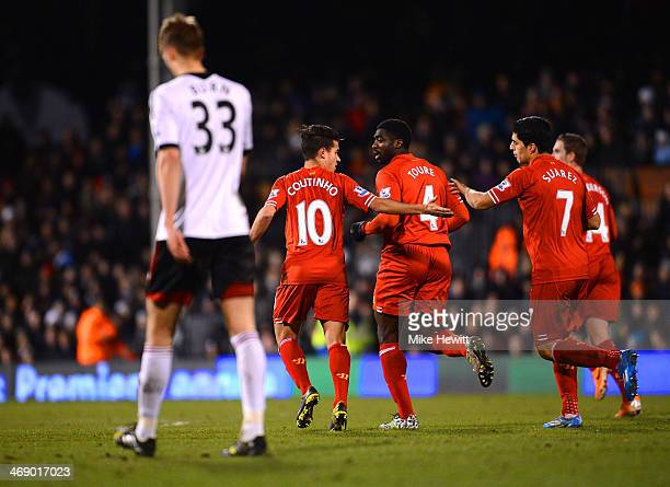 Philippe Coutinho of Liverpool celebrates scoring their second goal with Luis Suarez of Liverpool during the Barclays Premier League match between...