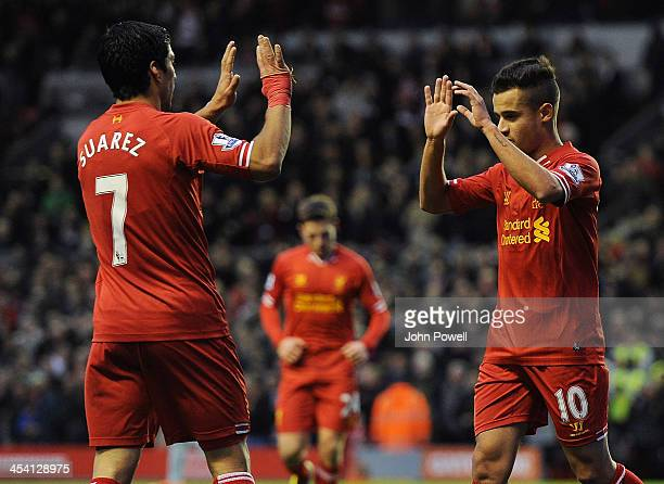 Philippe Coutinho of Liverpool celebrates the first goal with Luis Suarez during the Barclays Premier League match between Liverpool and West Ham...