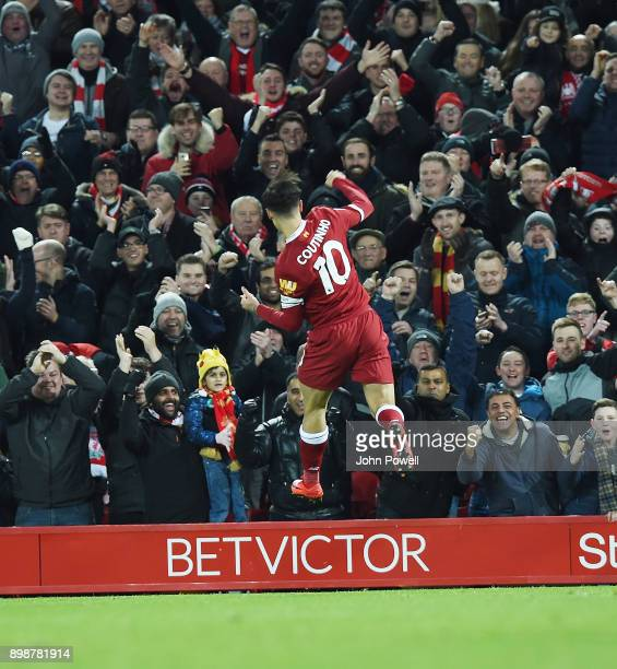 Philippe Coutinho of Liverpool Celebrates the opener during the Premier League match between Liverpool and Swansea City at Anfield on December 26...
