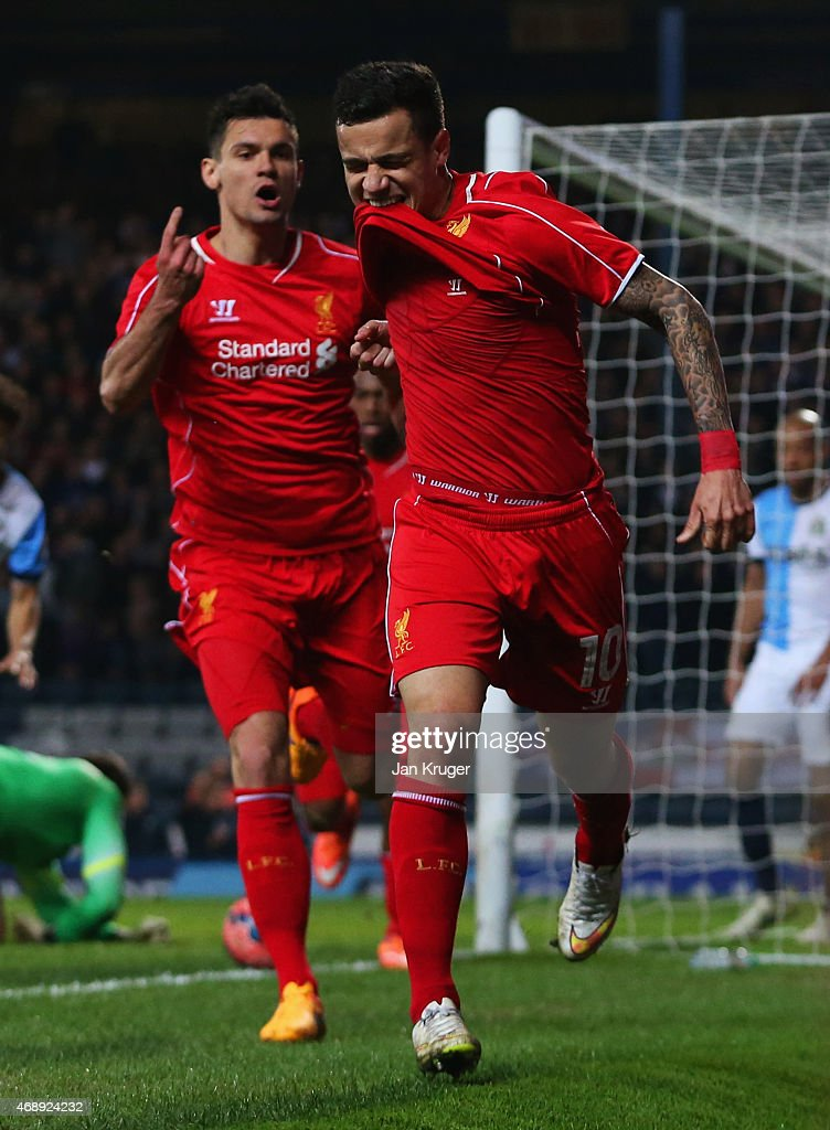 Philippe Coutinho of Liverpool (10) celebrates with Dejan Lovren as he scores their first goal during the FA Cup Quarter Final Replay match between Blackburn Rovers and Liverpool at Ewood Park on April 8, 2015 in Blackburn, England.