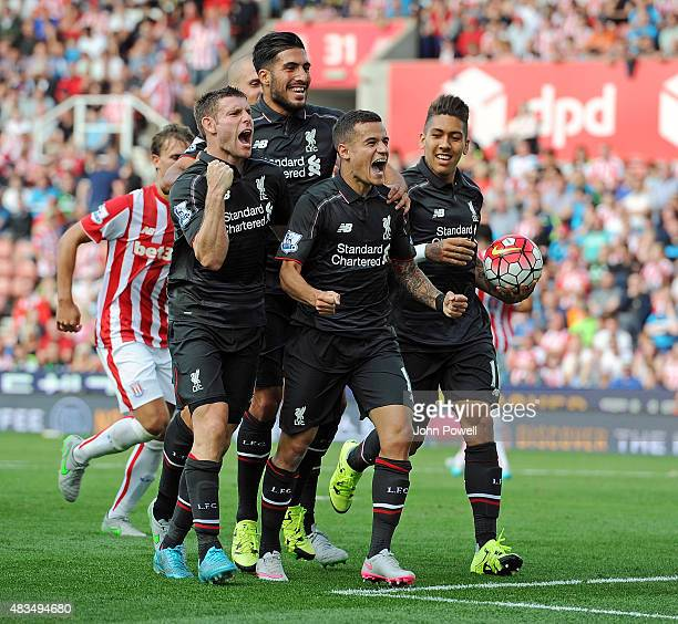 Philippe Coutinho of Liverpool celebrates with his team mates after scoring the opening goal during the Barclays Premier League match between Stoke...