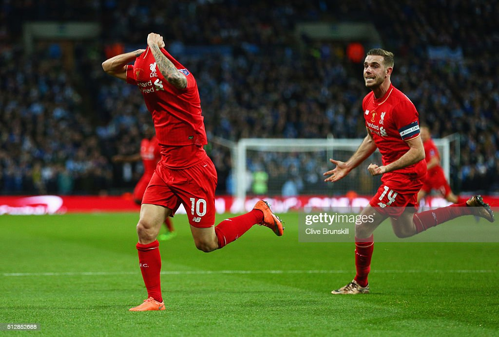 Philippe Coutinho of Liverpool (10) celebrates with Jordan Henderson (14) as he scores their first and equalising goal during the Capital One Cup Final match between Liverpool and Manchester City at Wembley Stadium on February 28, 2016 in London, England.