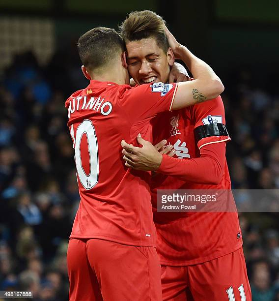 Philippe Coutinho of Liverpool celebrates with Roberto Firmino after scoring the second during the Barclays Premier League match between Manchester...
