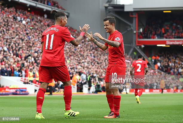 Philippe Coutinho of Liverpool celebrates with Roberto Firmino of Liverpool as he scores their fourth goal during the Premier League match between...