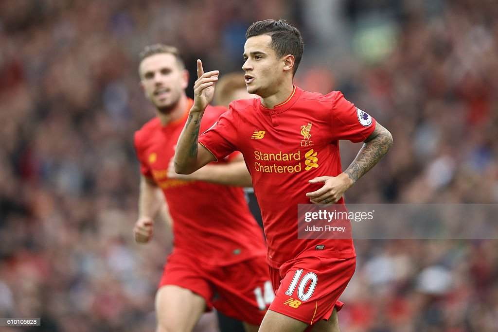 Philippe Coutinho of Liverpool celebrates with Sadio Mane as he scores their fourth goal during the Premier League match between Liverpool and Hull City at Anfield on September 24, 2016 in Liverpool, England.