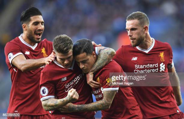 Philippe Coutinho of Liverpool celebrates with team mates after scoring his sides first goal during the Premier League match between Leicester City...