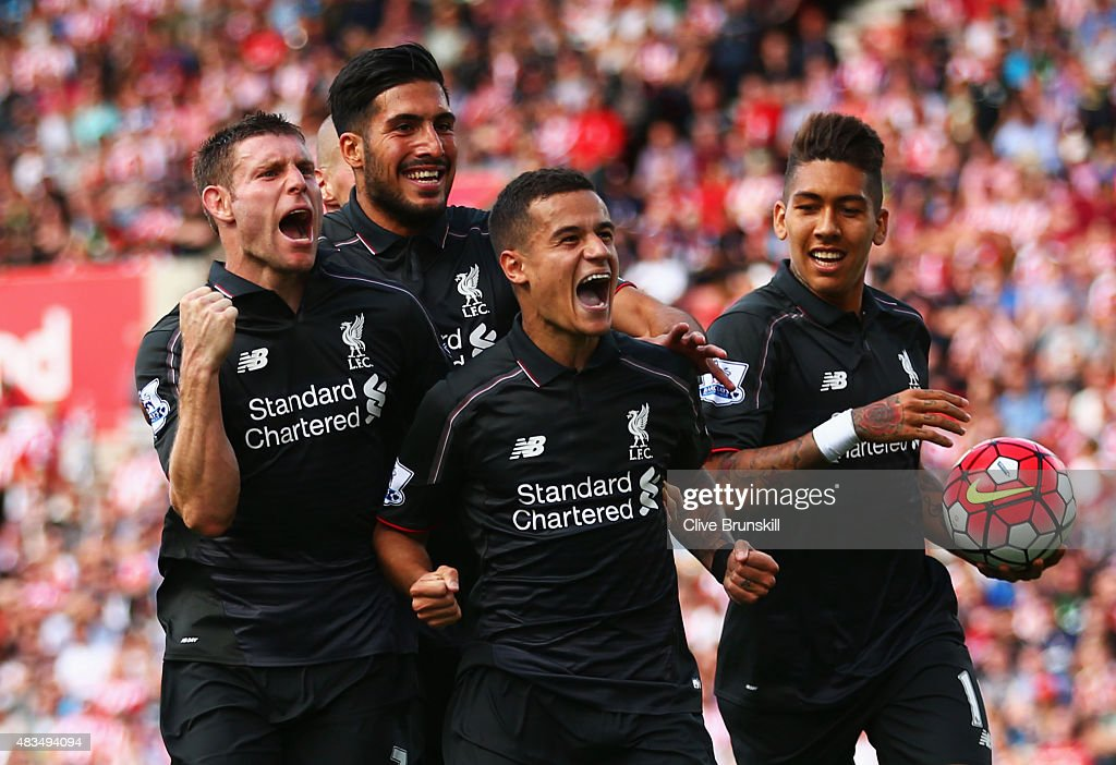 Philippe Coutinho of Liverpool (10) celebrates with team mates James Milner, Emre Can and Roberto Firmino of Liverpool as he scores their first goal during the Barclays Premier League match between Stoke City and Liverpool at Brittania Stadium on August 9, 2015 in Stoke on Trent, England.