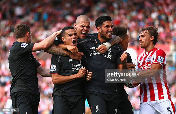 Philippe Coutinho of Liverpool celebrates with team mates James Milner, Martin Skrtel, Emre Can and Roberto Firmino of Liverpool as he scores their...