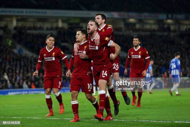 Philippe Coutinho of Liverpool celebrates with teammates including Jordan Henderson after scoring his team's fourth goal during the Premier League...