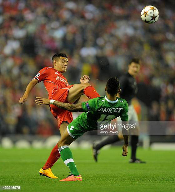 Philippe Coutinho of Liverpool competes with Anicet Abel of PFC Ludogorets during the UEFA Champions League match between Liverpool and PFC...