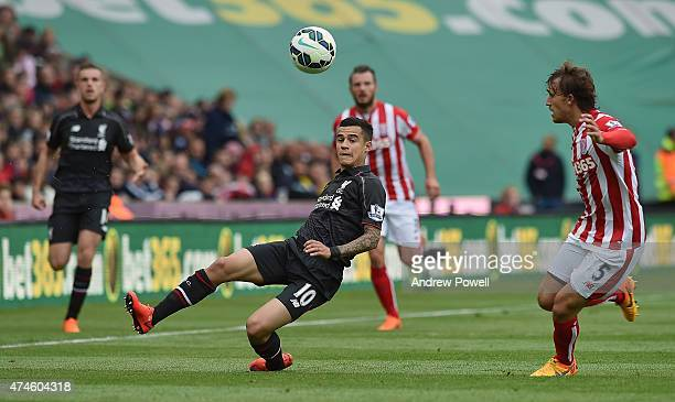 Philippe Coutinho of Liverpool competes with Erik Pieters of Stoke City during the Barclays Premier League match between Stoke City and Liverpool at...