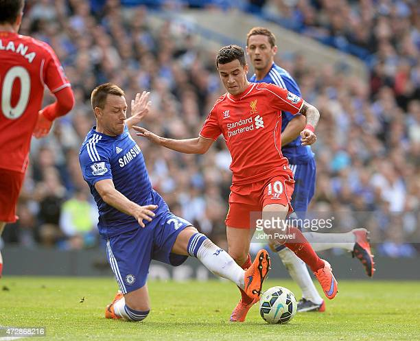 Philippe Coutinho of Liverpool competes with John Terry of Chelsea during the Barclays Premier League match between Chelsea and Liverpool at Stamford...
