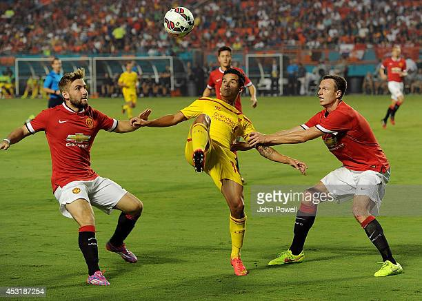 Philippe Coutinho of Liverpool competes with Jonny Evans and Luke Shaw of Manchester United during the International Champions Cup 2014 final match...