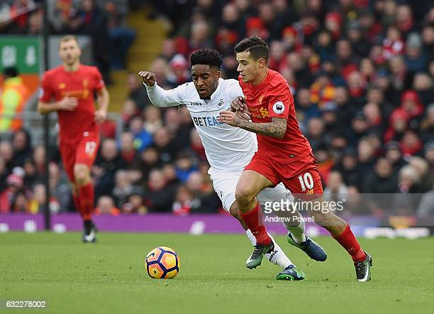 Philippe Coutinho of Liverpool competes with Leroy Fer of Swansea City during the Premier League match between Liverpool and Swansea City at Anfield...