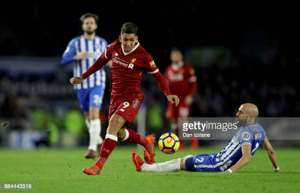 Philippe Coutinho of Liverpool escapes a challenge from Bruno Saltor of Brighton and Hove Albion during the Premier League match between Brighton and...