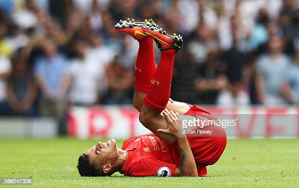 Philippe Coutinho of Liverpool goes down injured during the Premier League match between Tottenham Hotspur and Liverpool at White Hart Lane on August...