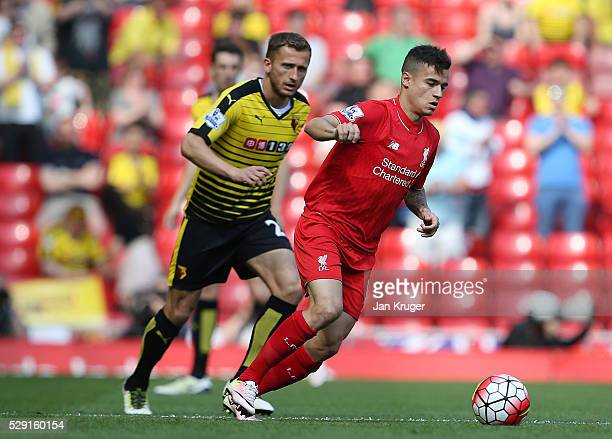 Philippe Coutinho of Liverpool holds off Almen Abdi of Watford during the Barclays Premier League match between Liverpool and Watford at Anfield on...