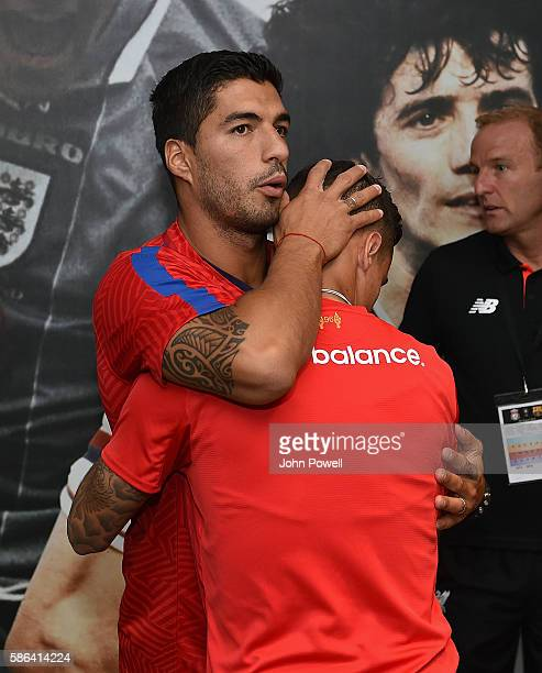 Philippe Coutinho of Liverpool hugs Luis Suarez of Barcelona before the International Champions Cup match between Liverpool and Barcelona at Wembley...