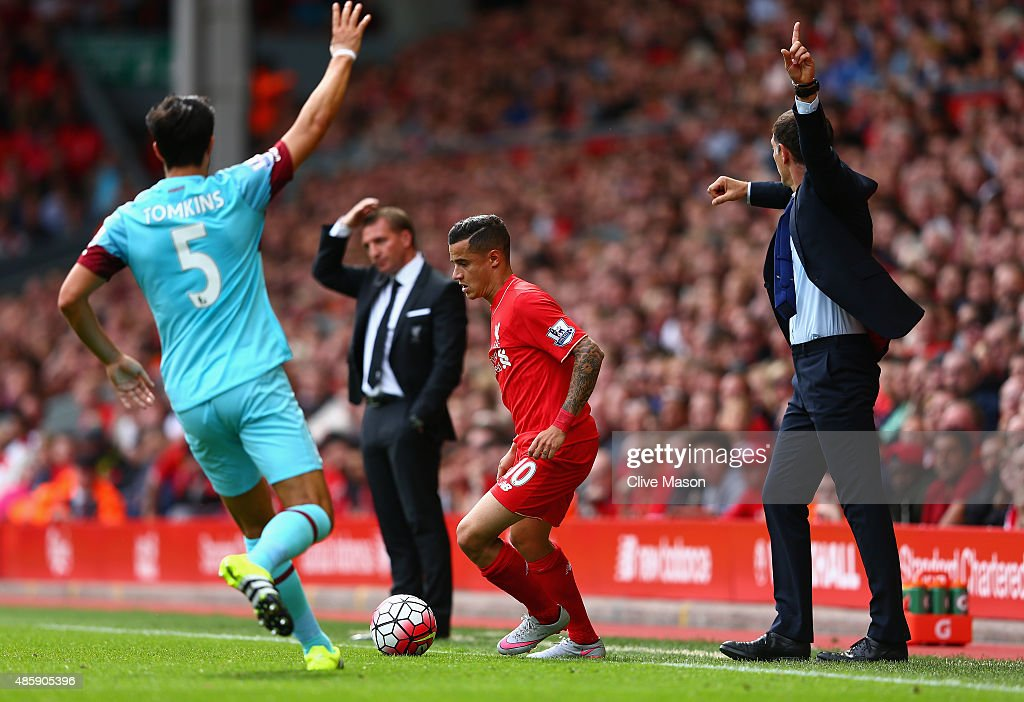 Philippe Coutinho of Liverpool in action as Brendan Rodgers of Liverpool looks on during the Barclays Premier League match between Liverpool and West Ham United at Anfield on August 29, 2015 in Liverpool, United Kingdom.