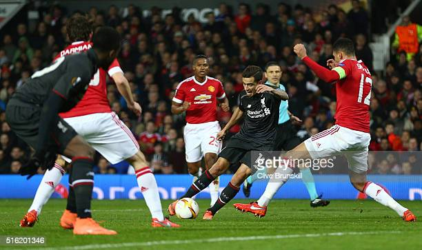 Philippe Coutinho of Liverpool is blocked by Chris Smalling of Manchester United during the UEFA Europa League round of 16 second leg match between...