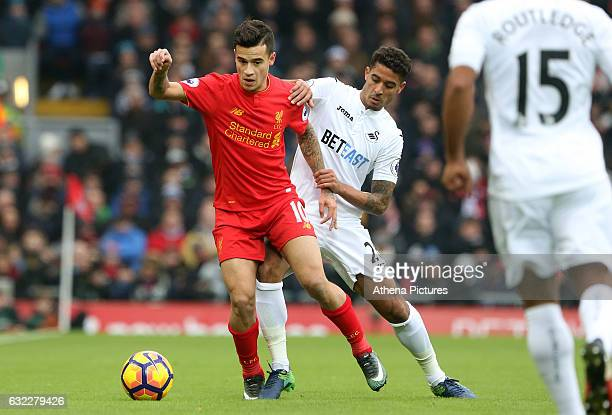 Philippe Coutinho of Liverpool is challenged by Kyle Naughton of Swansea City during the Premier League match between Liverpool and Swansea City at...