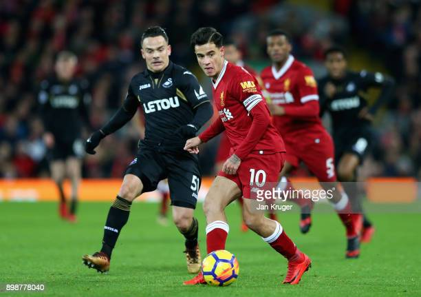 Philippe Coutinho of Liverpool is closed down by Roque Mesa of Swansea City during the Premier League match between Liverpool and Swansea City at...