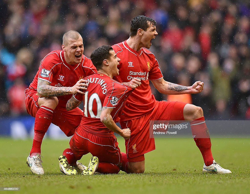 Philippe Coutinho of Liverpool is congratulated after his goal during the Barclays Premier League match between Liverpool and Manchester City at Anfield on March 1, 2015 in Liverpool, England.
