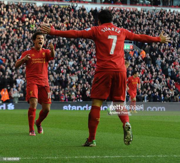 Philippe Coutinho of Liverpool is congratulated by Luis Suarez of Liverpool after his goal during the Barclays Premier League match between Liverpool...