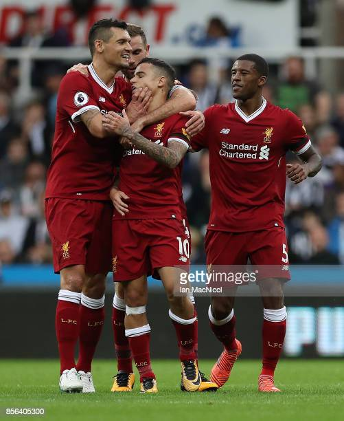 Philippe Coutinho of Liverpool is congratulated by team mates after opening the scoring during the Premier League match between Newcastle United and...
