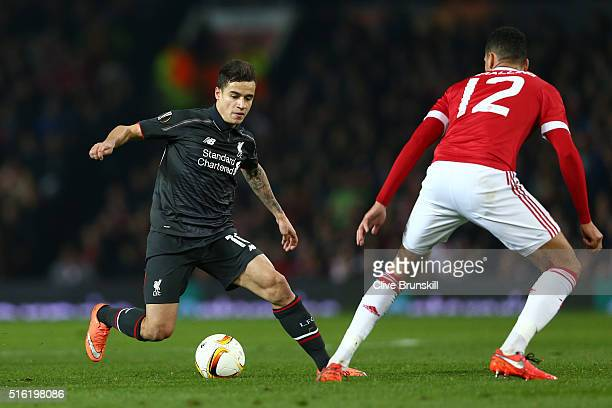 Philippe Coutinho of Liverpool is faced by Daley Blind of Manchester United during the UEFA Europa League round of 16 second leg match between...