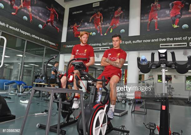 Philippe Coutinho of Liverpool is pictured with Adam Bogdan of Liverpool on his return for his first day back at Melwood Training Ground on July 11...