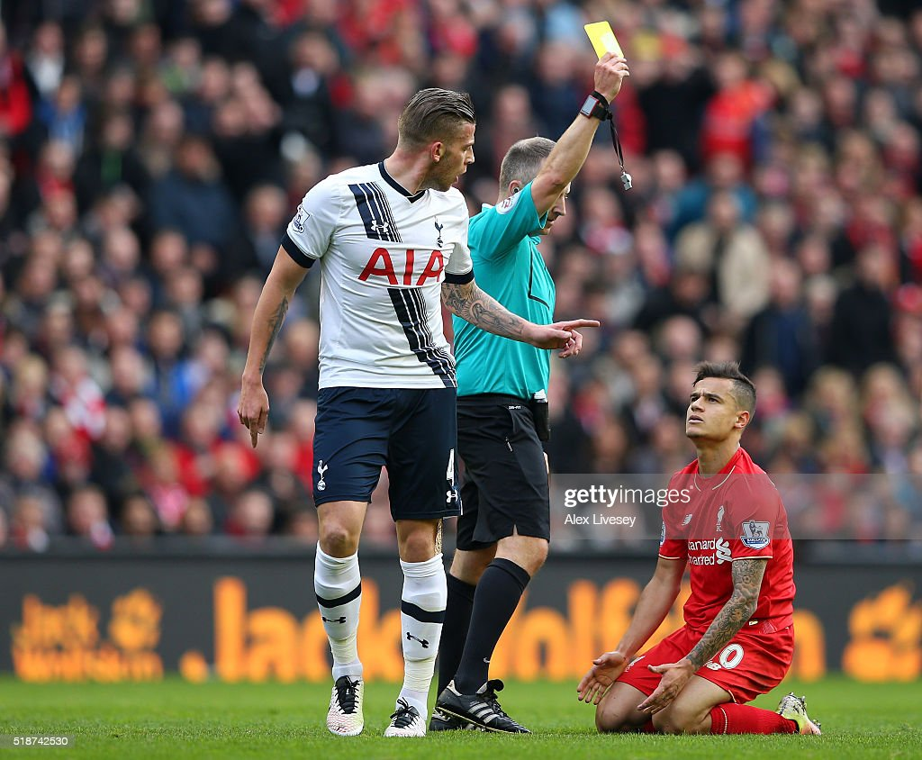 Philippe Coutinho of Liverpool is shown a yellow card by referee Jonathan Moss during the Barclays Premier League match between Liverpool and Tottenham Hotspur at Anfield on April 2, 2016 in Liverpool, England.