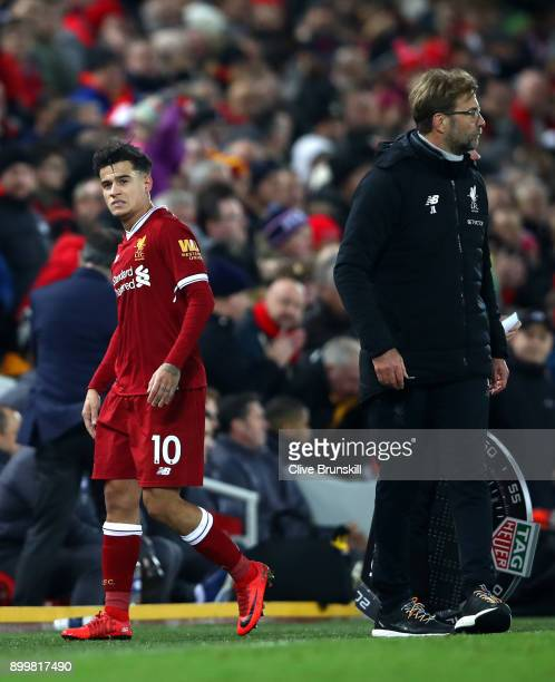 Philippe Coutinho of Liverpool leaves the pitch after being substituted off during the Premier League match between Liverpool and Leicester City at...