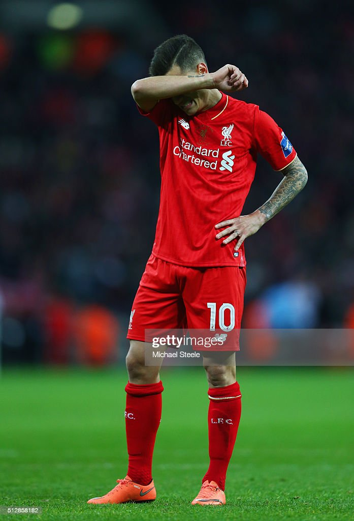 Philippe Coutinho of Liverpool looks dejected as he misses a penalty in the shoot out during the Capital One Cup Final match between Liverpool and Manchester City at Wembley Stadium on February 28, 2016 in London, England.