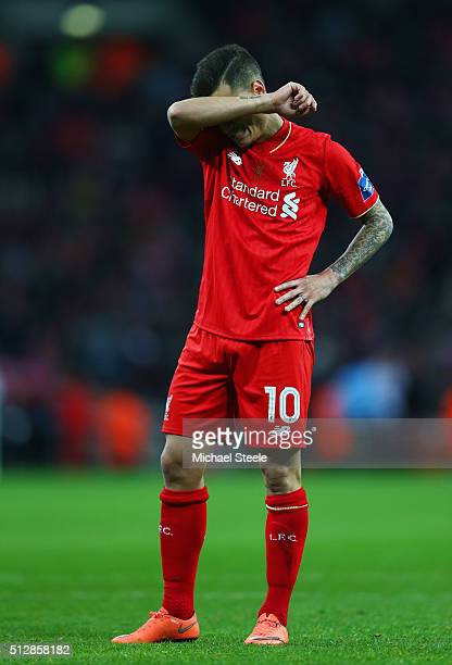 Philippe Coutinho of Liverpool looks dejected as he misses a penalty in the shoot out during the Capital One Cup Final match between Liverpool and...