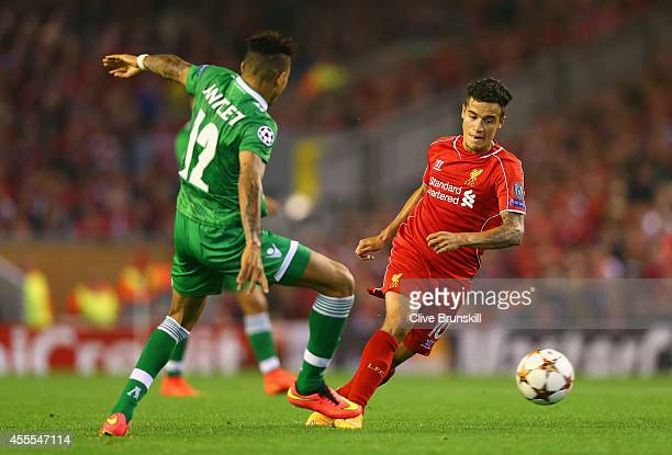 Philippe Coutinho of Liverpool looks to go past Anicet Abel of PFC Ludogorets Razgrad during the UEFA Champions League Group B match between...