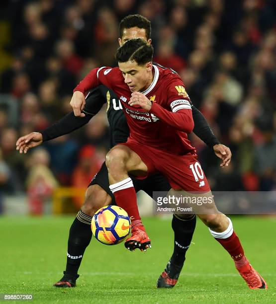 Philippe Coutinho of Liverpool powers through during the Premier League match between Liverpool and Swansea City at Anfield on December 26 2017 in...