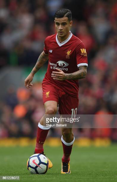 Philippe Coutinho of Liverpool runs with the ball during the Premier League match between Liverpool and Manchester United at Anfield on October 14...