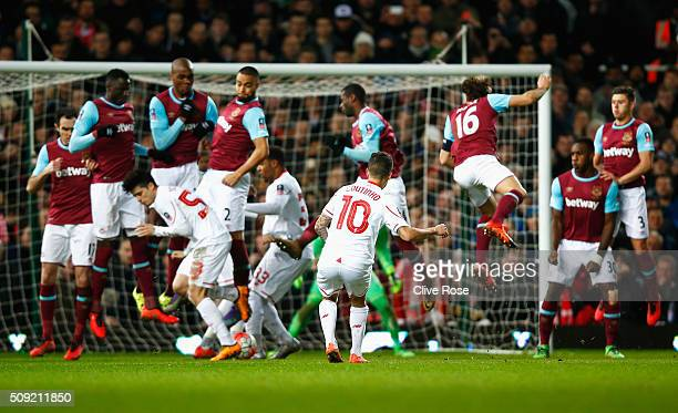 Philippe Coutinho of Liverpool scores from a freekick during the Emirates FA Cup Fourth Round Replay match between West Ham United and Liverpool at...