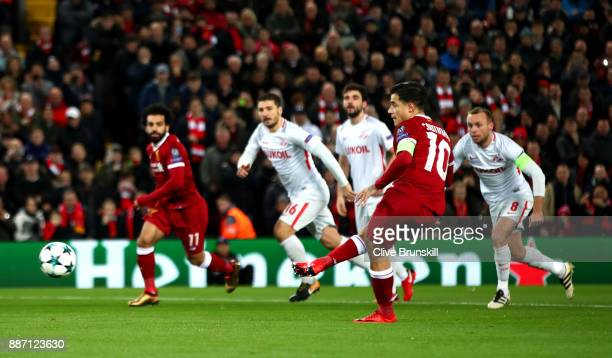 Philippe Coutinho of Liverpool scores his sides first goal during the UEFA Champions League group E match between Liverpool FC and Spartak Moskva at...
