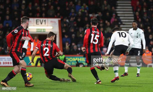 Philippe Coutinho of Liverpool scores his sides first goal during the Premier League match between AFC Bournemouth and Liverpool at Vitality Stadium...