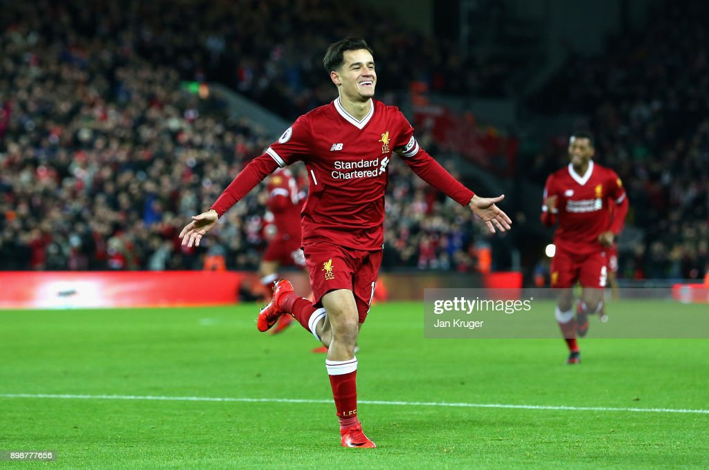 Philippe Coutinho of Liverpool scores his sides first goal during the Premier League match between Liverpool and Swansea City at Anfield on December 26, 2017 in Liverpool, England.